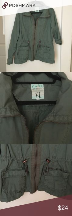 NWOT! Jacket NWOT! Jacket. Studded Details above left pocket. Both pockets have button closures. Drawstring cinches the waist when pulled. You can wear the sleeves two ways - both styles are pictured for reference. Excellent condition! Jackets & Coats