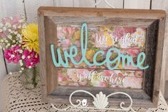 An easy-to-make, adorable, cheerful DIY welcome sign using a repurposed frame. Perfect piece of decor to bring some color and fun to an entryway table!