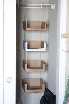 Creative recycling project: recycle corrugate boxes into hanging shelf system. #recycle #recycle_corrugate #corrugate #boxes #recycling