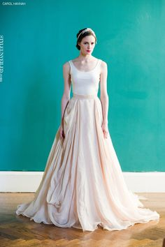 A minimalist top and full flowing skirt make this dress sophisticated and elegant (By Carol Hannah)