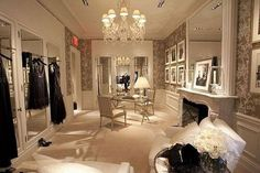 Nice walk in closet - love how it's more like a clean room than a closet!