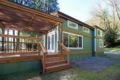 Meet the Whidbey; a modern, rustic cottage on Washington's Lake Whatcom. It is one of several cottages at the luxury Wildwood Lakefront Cottages, located just north of Bellingham by West Coast Homes, with 400 sq ft of space.