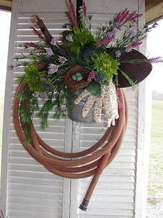 Who doesn't have an old water hose to use for this craft? What a great idea! Make one and decorate your garden area or your porch...wherever!