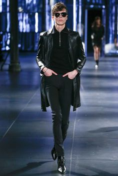 Leather overcoat, black denim and boots.Saint Laurent Fall 2015 Menswear Fashion Show