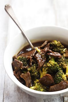 Super easy Slow Cooker Broccoli Beef with the most AMAZING sauce - and it's so much tastier and healthier than take-out!