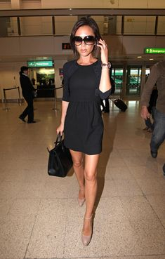 Victoria Beckham looked ultra-tiny in an LBD and cardigan at the airport.