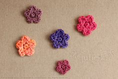 I wanted to make some tiny crochet flowers last week, and figured I could just add a petal to my four leaf clover pattern. Five petals were too bulky, however, and they looked crowded. I reworked t...