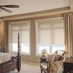 Silhouette window coverings and drapery panels are used to complete the room. Another happy client! www.sheilaswindowtoppers.com
