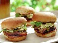 "Caja China-Roasted ""Peking"" ""Pekin"" Pulled Duck Sliders with BBQ Creme Fraiche and Pickled Grilled Green Onions recipe from Bobby Flay via Food Network"