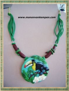 Tucan bass relief polymer clay necklace