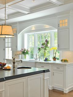 Remove two windows from kitchen, replace with one large central one. Note curved moulding over, to match with feature over hob.