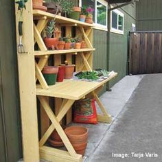 potting table made from a picnic table