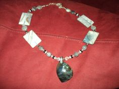 large labradorite center stone accented with stone, glass & silver beads with 4 large rectangle sea shell beads by Sharonsroxnwrapps on Etsy