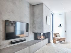 Anthony Concrete Design adds modern style to any space, creating industrial chic designs with the distinct character of concrete. Concrete Fireplace, Home Fireplace, Modern Fireplace, Living Room With Fireplace, Fireplace Surrounds, Fireplace Design, Living Room On A Budget, Home Living Room, Living Room Decor