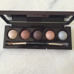 Laura Mercier Eye Palette LM Dry/Wet shadows. Perfect for everyday or evening makeup. Can wet them and use as a longer wearing eye makeup. Never been used. No swatches. No box. Will ship in bubble wrap as well so it will get to you in perfect condition just as shown. Purging makeup and so much unused in my kit so listing it here. A+ condition. 100% authentic. No trades. Laura Mercier Makeup Eyeshadow