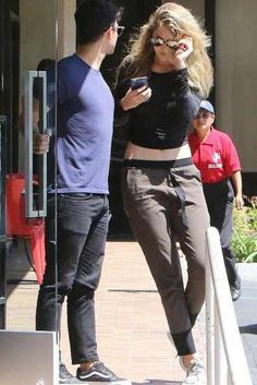 Gigi Hadid wearing Victoria Beckham Modern Aviator Sunglasses in Mirage, Adidas Yeezy Boost 350 Sneakers, Line Dry Britt Patns and Gypsy 05 Bamboo Shirred Long Sleeve Top