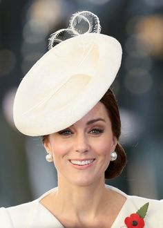 Kate Middleton Photos Photos - Prince William, Duke of Cambridge and Catherine, Duchess of Cambridge attend the Last Post ceremony, which has taken place every night since 1928, at the Commonwealth War Graves Commission Ypres (Menin Gate) Memorial on July 30, 2017 in Ypres, Belgium. The Duke and Duchess of Cambridge are joined by two hundred descendants whose ancestors are named on the Gate, alongside representatives from nations who fought on the Salient. The commemorations mark the…