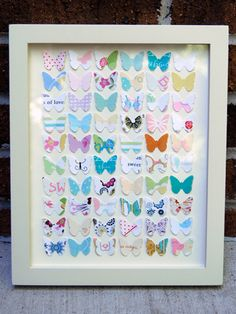 Paper Butterflies - cute idea to use cards received for a special occasion & cut them into shapes & frame.