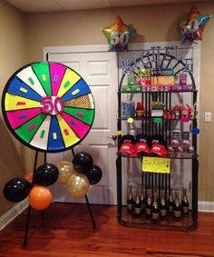 Spin the wheel and claim your prize. See more 50th birthday party games and party ideas at www.one-stop-party-ideas.com