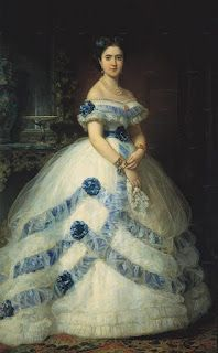 Ballgown ca. 1860  This is what I'm going to dress my blue ball-gown like! I already have the top pretty much done since it's trimmed in blue lace and bows. :)