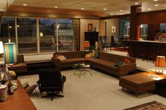 I absolutely love, pretty much all of the furniture on Mad Men.  This couch!  Great article on inspiration and shopping for the set and also pictures of the rooms without anyone in them.