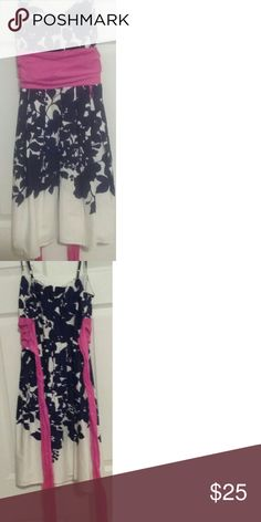 A floral black and white dress It is a above knee ,spaghetti strap, black and white floral dress with pink sash B Darlin Dresses Midi