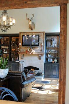 Rustic livingroom wood beams fall fireplace