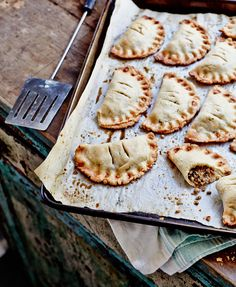 """Hearty handheld bites that have become a Louisiana traditionThe savory hand pies from Natchitoches (That's """"NACK-A-TUSH""""), Louisiana—perhaps best known as the setting for the movie Steel Magnolias—are not unlike the empanadas of Spain and Latin America. Filled with ground beef sautéed with the holy t"""