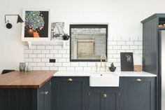 Created for a design-conscious family in London's East Dulwich, the latest kitchen from deVol caters to a lot of tastes: Darkly elegant thanks to a palette