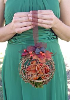 What a unique bridesmaid bouquet ! I would stuff it with a cream-colored plastic bath sponge as filler and surround it with flowers, top it with a bow and make the string to hold it a strand of pearls :D