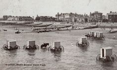 The bathing machine was a device, popular in the 18th and 19th centuries, to allow people to change out of their usual clothes, possibly change into swimwear and then wade in the ocean at beaches. Bathing machines were roofed and walled wooden carts rolled into the sea. Some had solid wooden walls; others had canvas walls over a wooden frame.