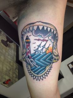 My boyfriends new tattoo! Shark jaws traditional. Lighthouse. Beach