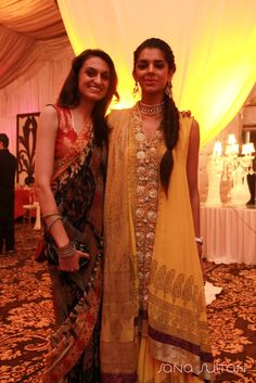 Tania (Left) rocking a Deepak Perwani Amrita Shergill Collection Sari (SRE-64) & Sanam Saeed donning a yellow Deepak Perwani Bridal Collection Outfit (KTD-2443) at Feeha Jamshed's Wedding.