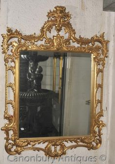 - Stunning English Chippendale style gilt mirror with rococo flourishes<BR> - Nice large size at almost 5.5 feet tall - or 170 CM<BR> - Definitely one to add space and light to any interior<BR> - Frame very intricate in gilt with leaf and foliate motifs, shell designs and the elegant cartouche to the top<BR> - Glass is clear and blemish free ready to add light and space to any interior<BR> - Purchased from a dealer at Newark Antiques fair in England<BR> - Offered in great shape ready for…