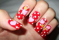 red nail art with heart