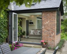 Bi-fold doors in Hampshire add a contemporary feel to orangeries and conservatories. View our aluminium Bi-Fold Door range and get a FREE quote. Garage Extension, House Extension Design, House Design, Extension Ideas, Small Conservatory, Conservatory Extension, Conservatory Interiors, Conservatory Design, Garden Room Extensions
