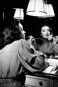 Linda Darnell putting on make-up in mirror, photographed by Herbert Gehr, c. 1940s.