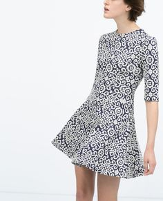 This dress is too short for me, but I love the high neckline (it makes it look retro) & jacquard fabric, as well as the fit-&-flare shape. If it were a few inches longer, I'd want it.