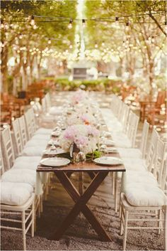 romantic outdoor reception, love the lights strung above the table, gives it a glittery appearance