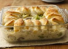 Chicken Alfredo Biscuit Casserole - Parmesan-crusted biscuits top this mouthwatering chicken Alfredo casserole that is sure to become a family standby.