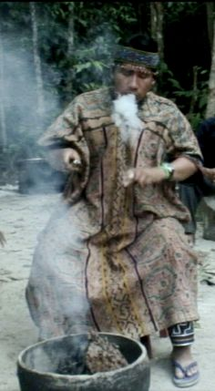 Maestro Heberto performing the Medicines' Smoke Ritual, Ashi Meraya, Peruvian Amazon