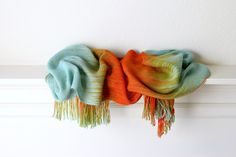 Hand woven long scarf made in pooling technique. This means that color is…