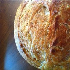 San Francisco Sourdough Bread  4 3/4 cups bread flour  3 tablespoons white sugar  2 1/2 teaspoons salt  1 (.25 ounce) package active dry yeast  1 cup warm milk  2 tablespoons margarine, softened  1 1/2 cups sourdough starter  1 extra large egg  1 tablespoon water  1/4 cup chopped onion