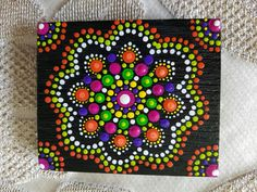 Hand Painted Dot Art Mandella on Timber by Katie Lynde info@executivegardening.com.au