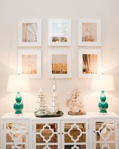 green lamps and mirrored cabinet