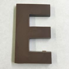 The letter E made of milk chocolate.