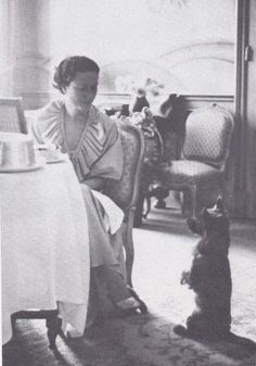 The Duchess of Windsor Wallis Simpson...love her jewels and her dog.