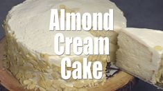 Light, moist and velvety, this Almond Cream Cake has a homemade cooked, whipped frosting that pairs perfectly with the almond cake. Decorate the cake simply with sliced almonds. #cake #creamcake #almond #dessert #homemade #frosting