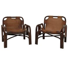 For Sale on 1stdibs - Pair of two lounge armchairs attributed to Tito Angoli and produced by the Italian manufacturer Bonacina in 1963. Perfect condition for a perfect living