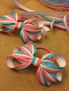 Lovely striped grosgrain ribbon hair bows in the making at dreambows :) Striped…
